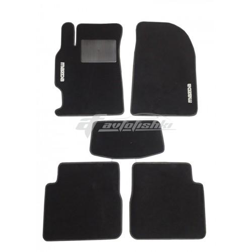 На фотографии ворсовые коврики в салон для Mazda 6 2007-2012 черного цвета
