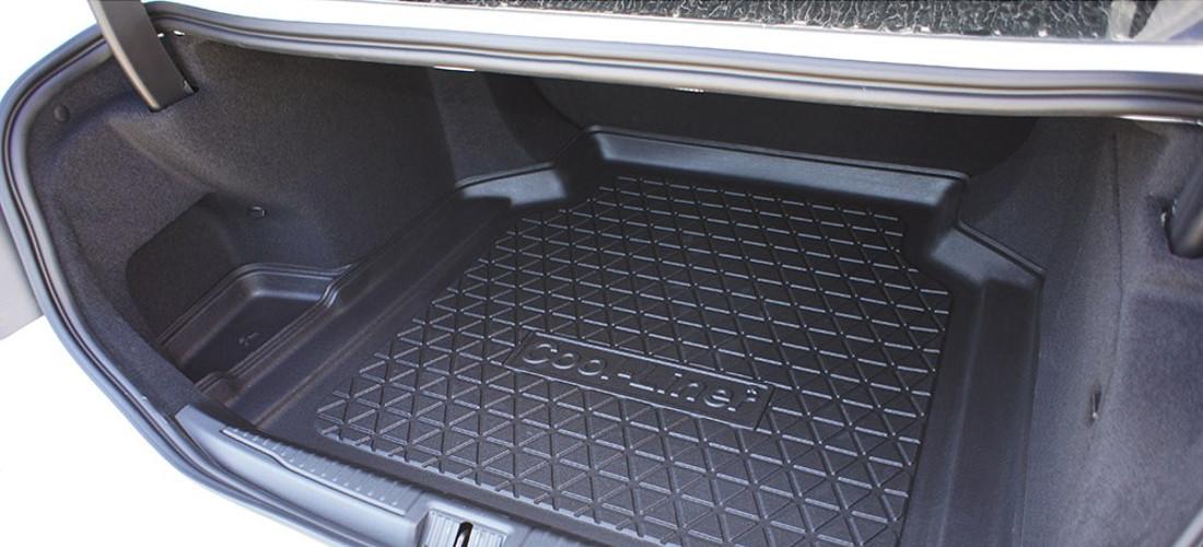 На фото коврик в багажник, Состав резина или полиуретан. Коврик в багажник защищает багажный отсек